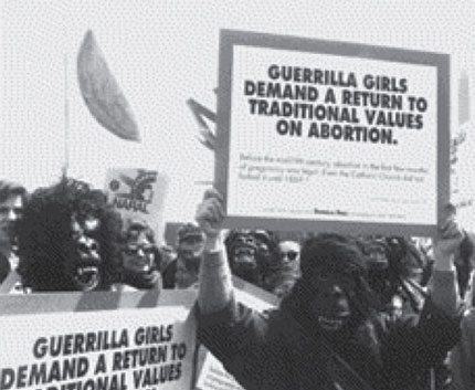 Members of the Guerrilla Girls marching in costume circa 1992.